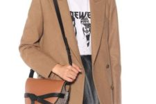 With labeled t-shirt, beige blazer and black leather skirt