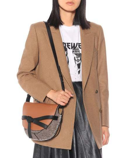 With labeled t shirt, beige blazer and black leather skirt