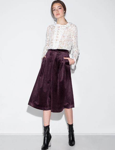 With lace blouse and black patent leather boots