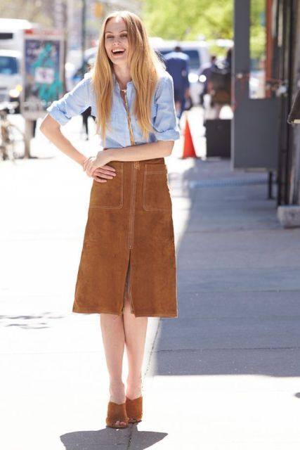 With light blue shirt and brown suede mules
