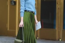 With light blue sweater, black belt, green bag and black high heels