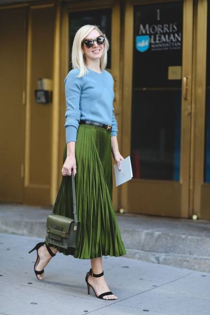 With light blue sweater, black belt, green bag and black high heels