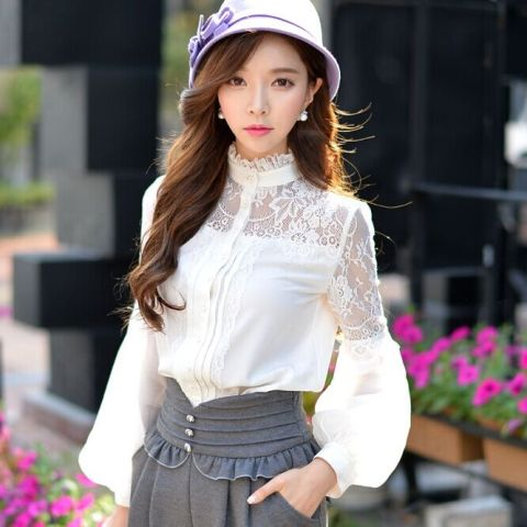 With lilac hat and gray high waisted skirt