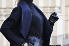 With navy blue coat, black leather tote bag, turtleneck and leather shorts
