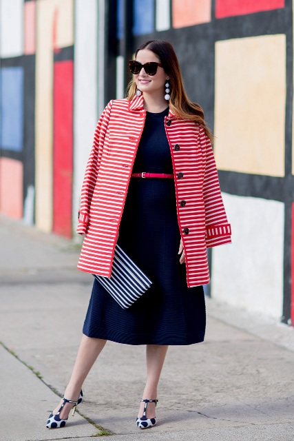 With navy blue midi dress, striped clutch, red belt and polka dot shoes