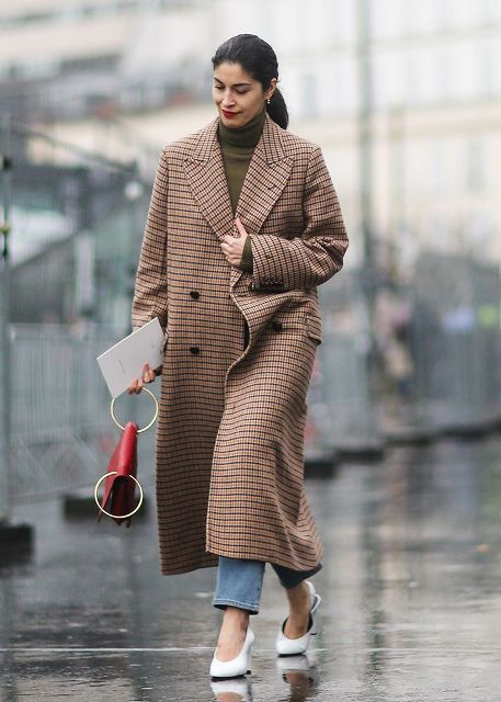 With olive green turtleneck, jeans, white shoes and red clutch