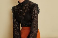 With orange high-waisted wide leg trousers