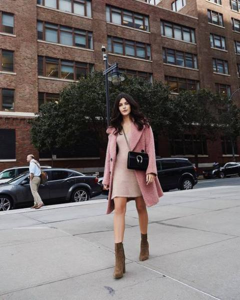 With pale pink mini dress, black chain strap bag and pink coat