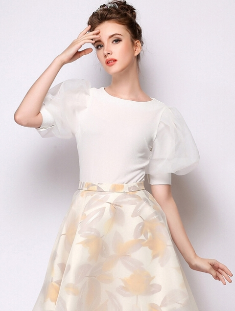 With pastel colored floral A-line skirt