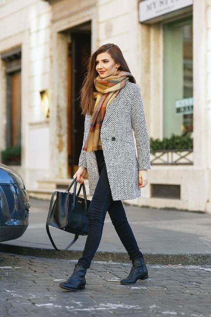 With plaid scarf, dark colored skinny jeans, black bag and black ankle boots