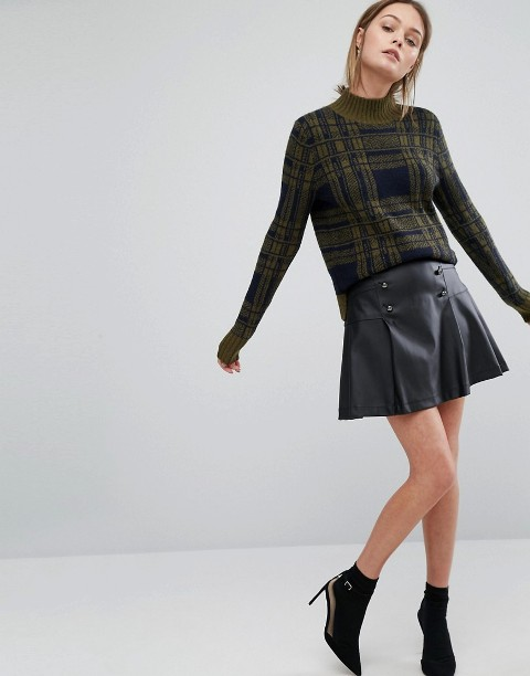 With plaid sweater and black ankle boots