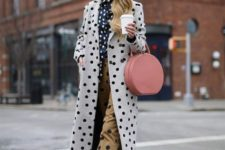 With polka dot blouse, polka dot trousers, two colored shoes and pale pink rounded bag
