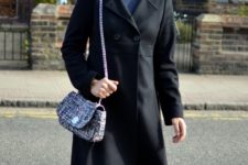 With printed dress, black coat and purple shoes