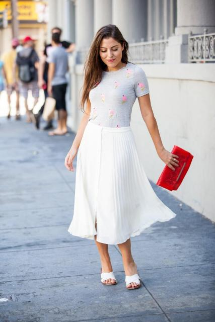 With printed t-shirt, red clutch and white mules