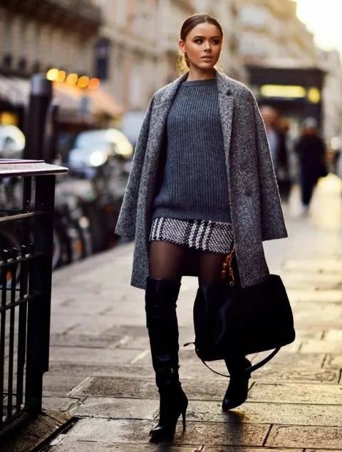 With printed tweed skirt, gray sweater, black tote bag and black over the knee boots