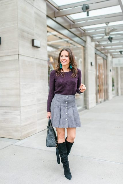 With purple shirt, high boots and gray bag