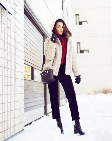 With red hoodie, black boots, black bag and white hooded jacket