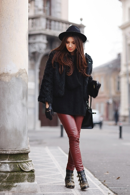 With red pants, embellished boots, wide brim hat, bag and fur jacket