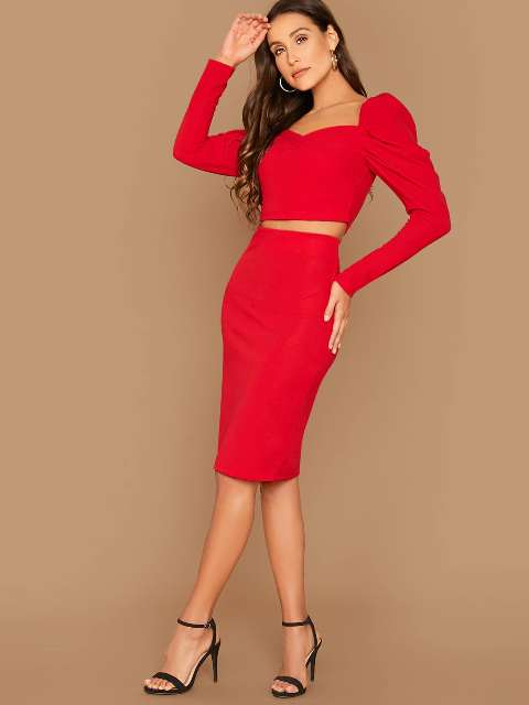 With red pencil skirt and black ankle strap heels