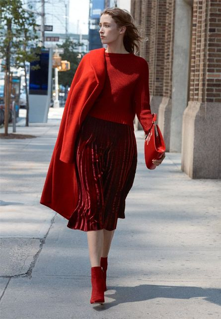 With red sweater, red coat, clutch and red suede ankle boots