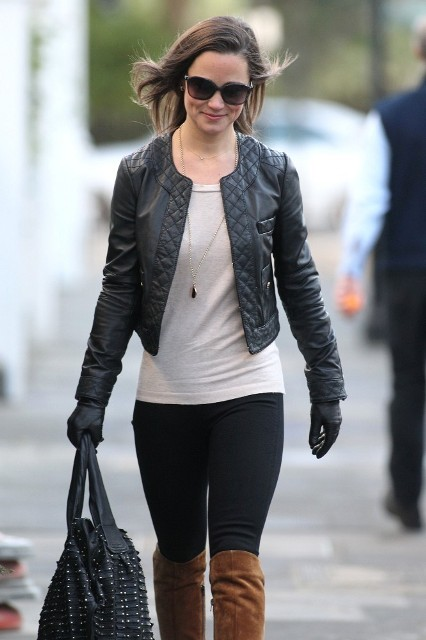 With shirt, skinny pants, embellished bag, brown high boots and black jacket