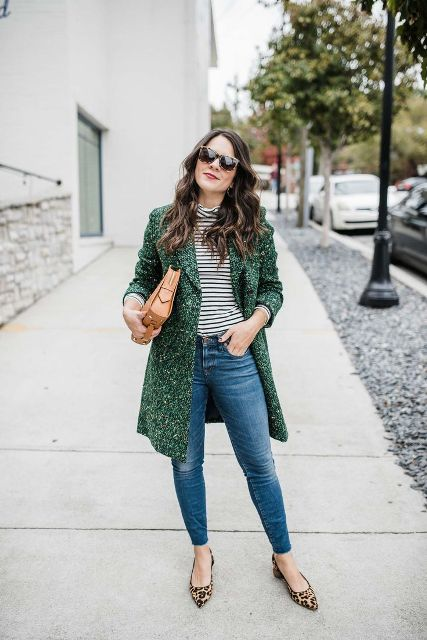 With striped shirt, brown clutch, jeans and leopard shoes