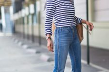 With striped shirt, sunglasses and brown bag