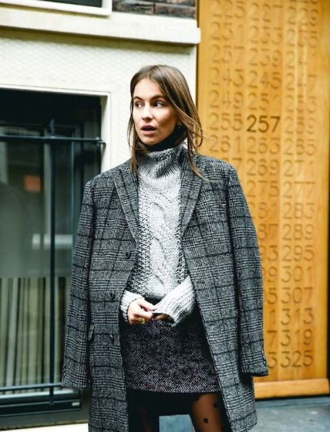 With turtleneck sweater and tweed mini skirt