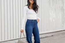 With white and gray striped shirt, printed bag and high heels
