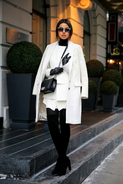 With white blazer, white coat, chain strap bag, white skirt and black over the knee boots