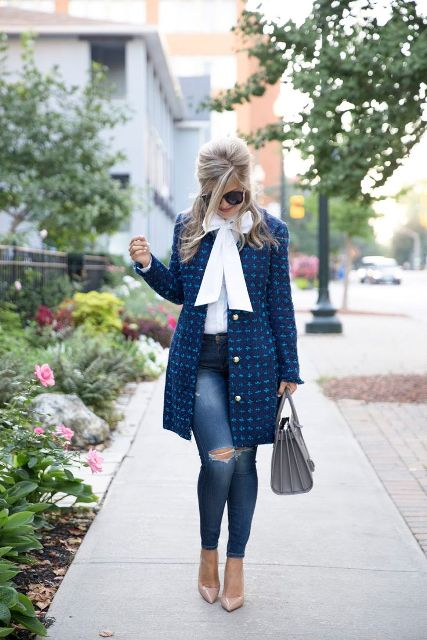 With white blouse, distressed jeans, gray bag and beige pumps