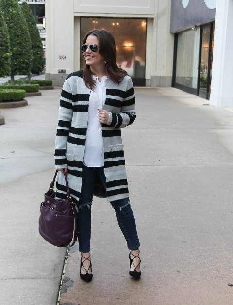 With white blouse, distressed jeans, purple bag and lace up high heels