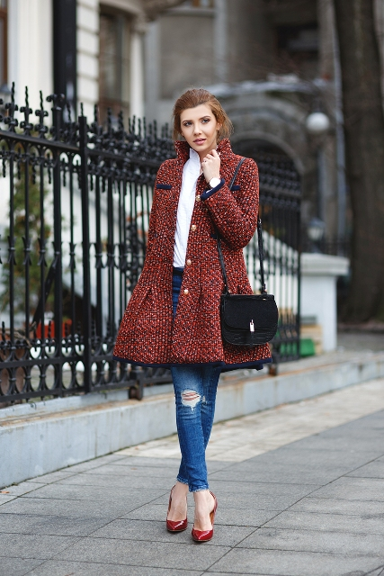 With white blouse, jeans, red pumps and black bag