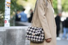 With white blouse, skirt and beige coat