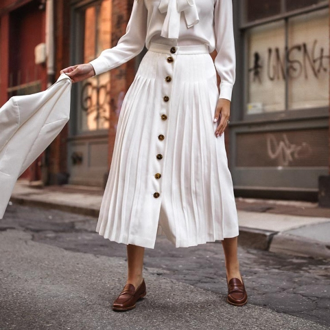 With white blouse, white blazer and brown flat shoes