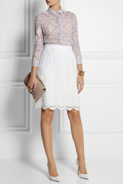With white lace knee length skirt, beige clutch and white pumps