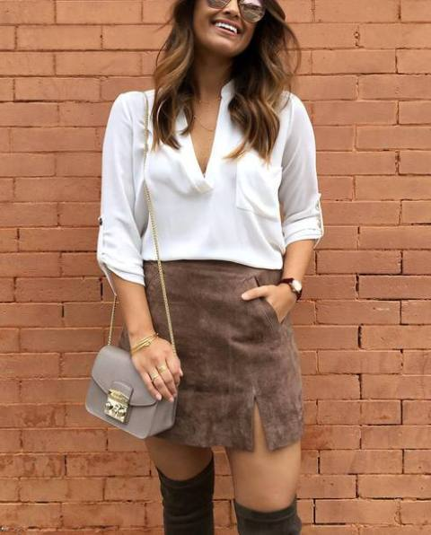 With white loose blouse, chain strap bag and over the knee boots
