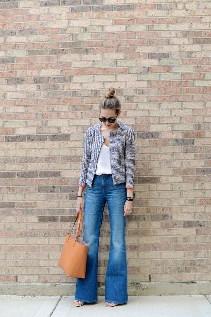 With white loose top, jacket and light brown tote bag