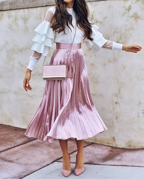 With white ruffled blouse, pale pink chain strap bag and pale pink pumps