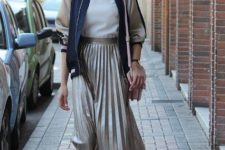 With white shirt, bomber jacket, beige bag and black pumps
