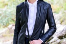 With white shirt, jeans, black leather jacket and cap