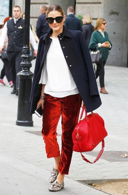 With white shirt, printed loafers, red bag and navy blue jacket