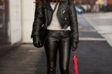 With white sweater, leather pants, leather jacket and platform boots