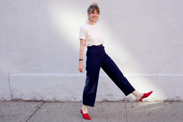 With white t-shirt and red low heeled mules