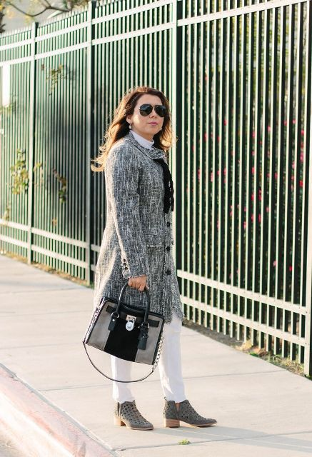 With white trousers, white turtleneck, gray and black bag and embellished boots