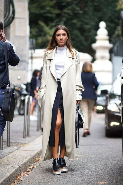 With white turtleneck, wrapped midi skirt, black bag and platform shoes