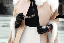 With white wrapped mini skirt, black high boots, black shirt and fur coat