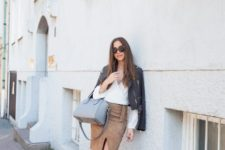 With white wrapped shirt, leather jacket, white sneakers and gray bag