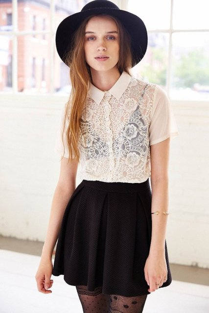 With wide brim hat, printed tights and black skater skirt