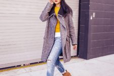 With yellow shirt, distressed cuffed jeans and knee-length coat